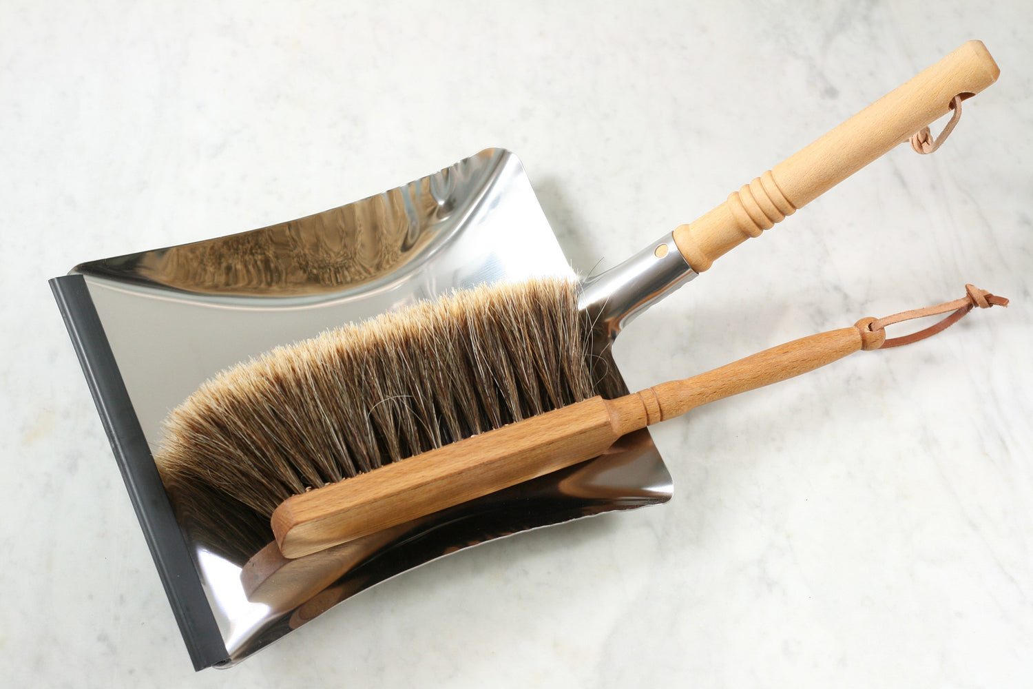 A German-style stainless steel dustpan with oiled beechwood handle from Burstenhaus Redecker.