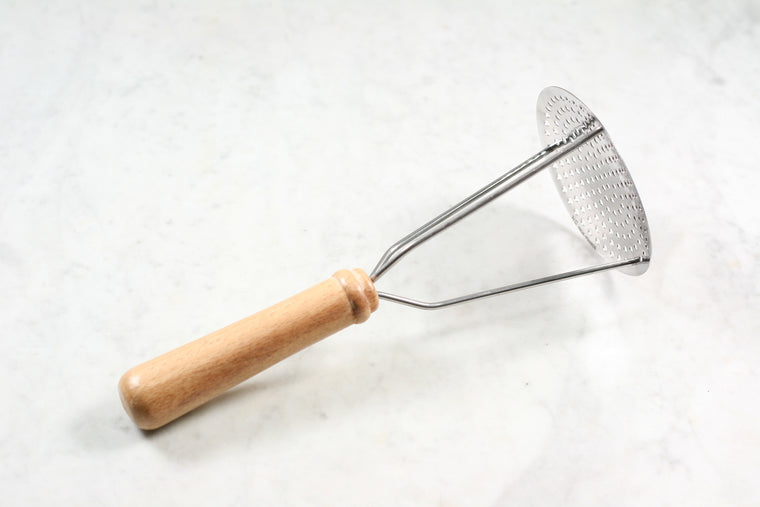 Stainless steel potato masher with wooden handle, made in France.