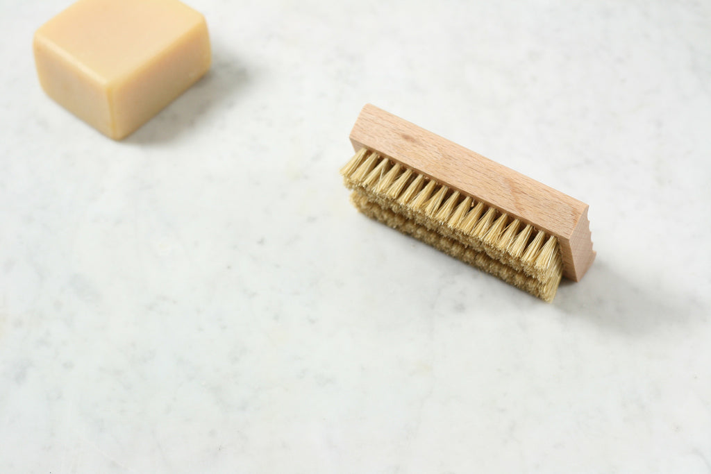 An oiled beechwood soap dish, with ridged surface, that does double duty as a nail brush. From Burstenhaus Redecker.