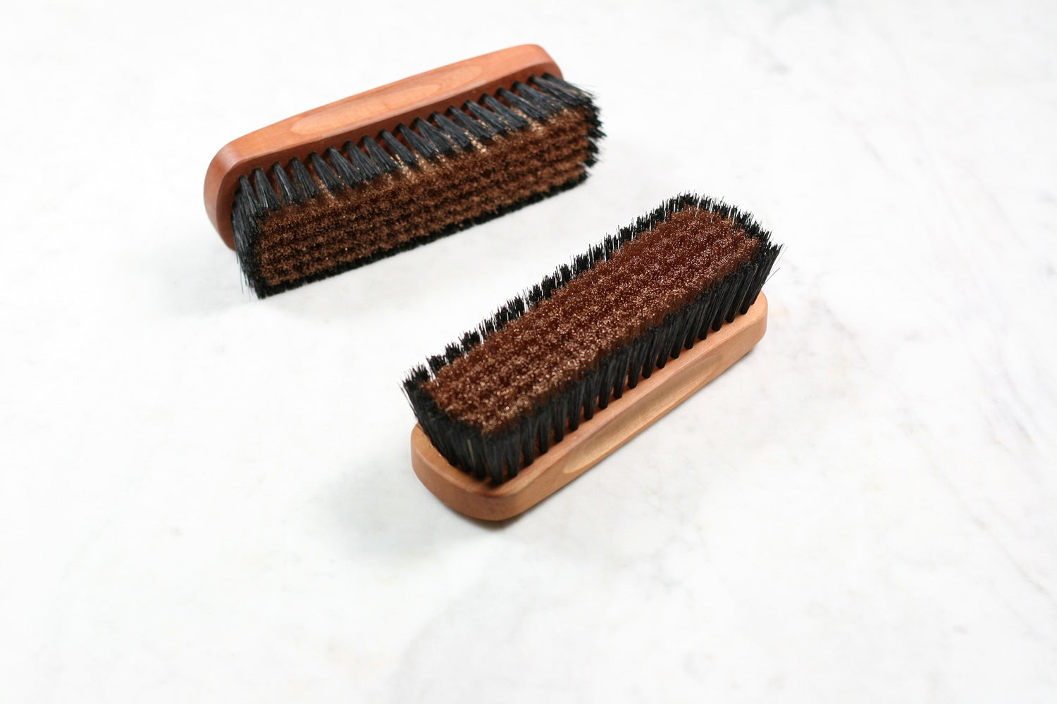 Burstenhaus Redecker sweater brush with natural and bronze bristles.