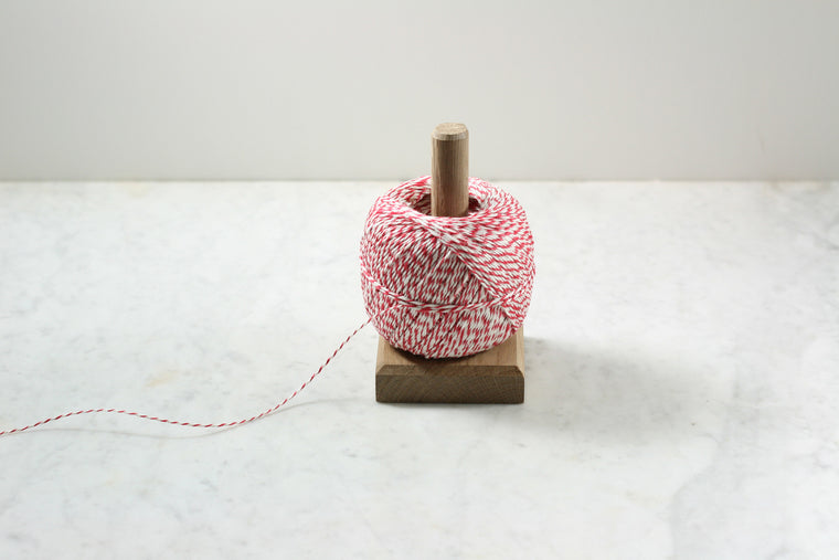 A simple wooden twine holder from Burstenhaus Redecker.