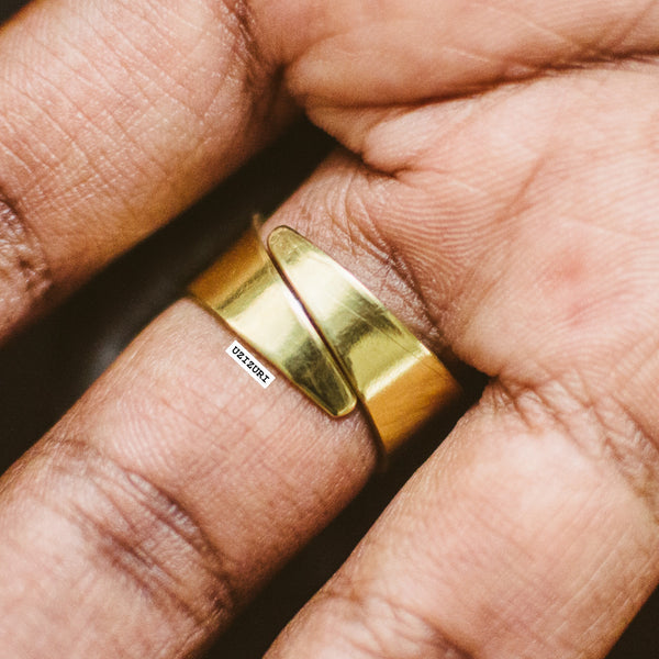 brass ring on finger