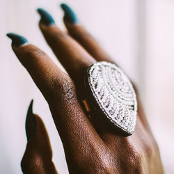 handmade statement ring on finger