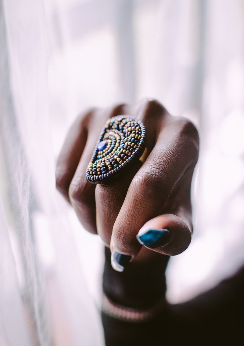 beaded statement ring on finger
