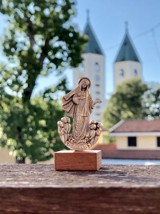 Tiny statue of Our Lady Queen of Peace