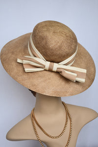 Brown woven hat with bow detail