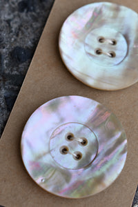 Rare lightweight Mother of Pearl buttons, x2