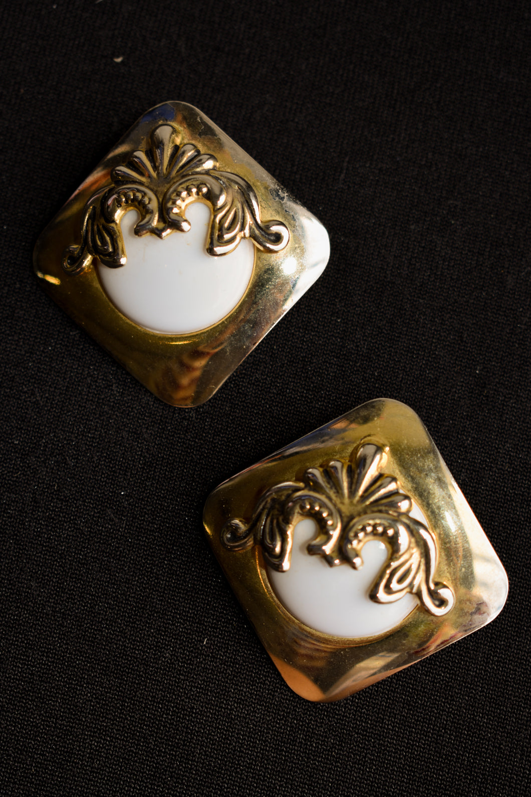 White and gold coloured clip on earrings