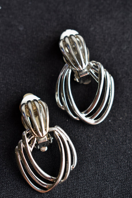 Silver coloured clip on earrings