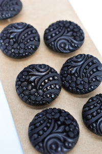 9x black textured buttons