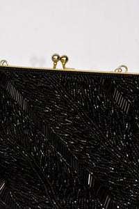 La Regale beaded clutch bag