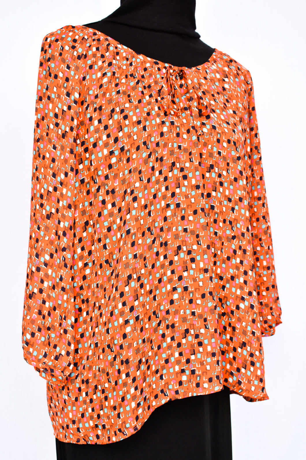 Orange patterned top, size 12