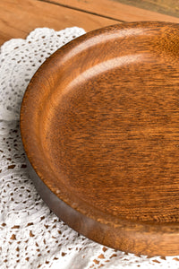 Shallow round wooden bowl