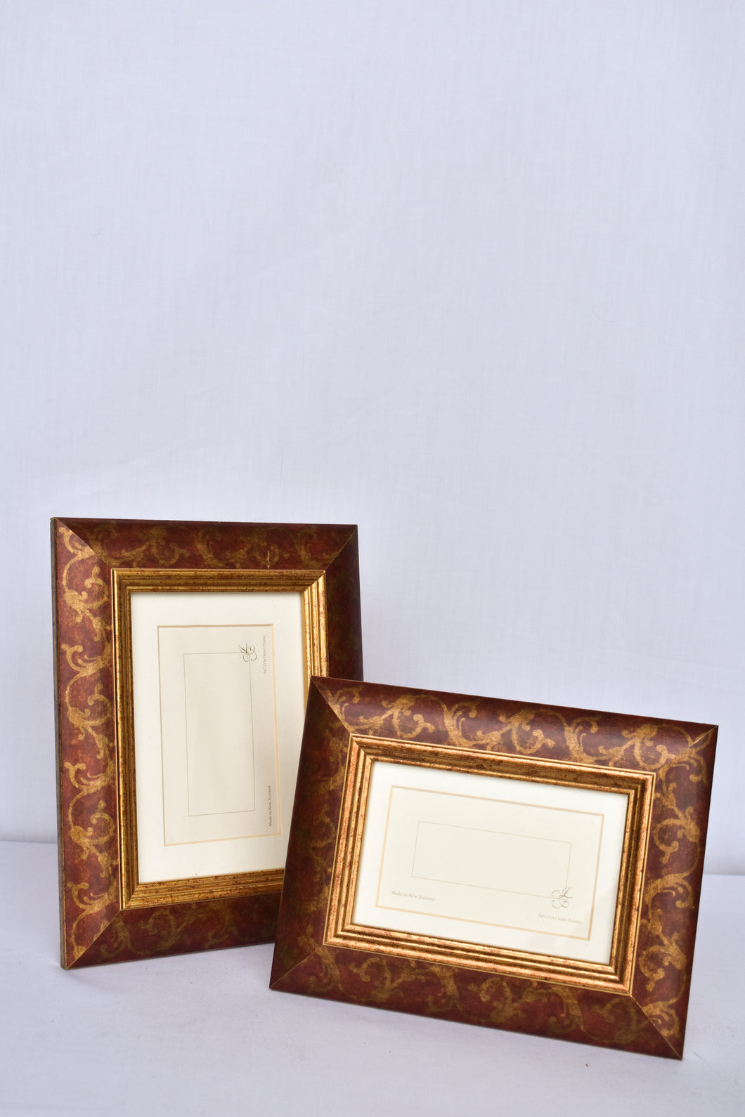 2x maroon and gold photo frames