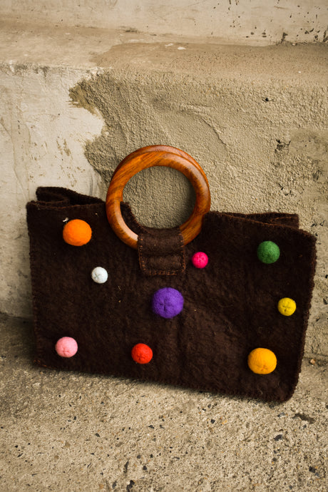 Handmade spotty wool bag with wooden handles