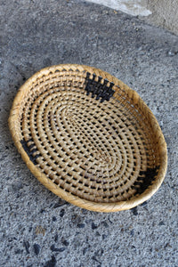 Sturdy oval shallow woven tray, 27cm long