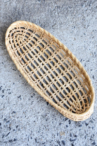 Long oval shallow woven tray, 35cm long