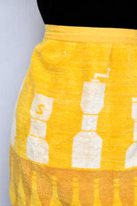 Yellow salt and pepper apron