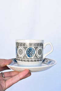 Blue and grey patterned mug and saucer