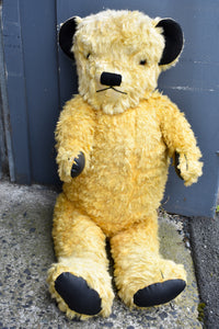 Vintage collectible oversized yellow teddy with growler