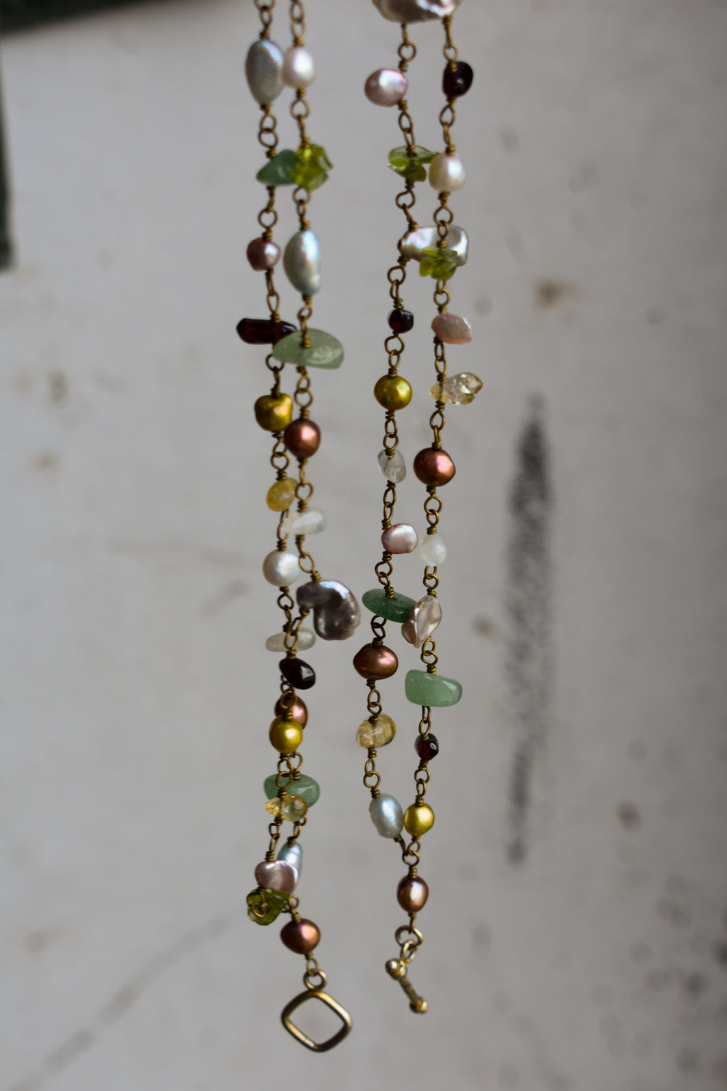 Long multicoloured bead and stone necklace