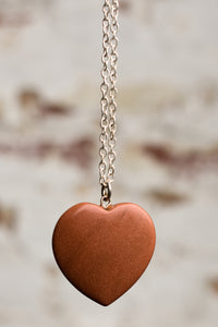 Rust coloured sparkly heart necklace
