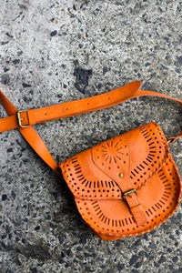 Orange cross body bag with cutouts
