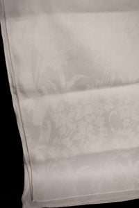 White damask communion cloth with embossed floral design