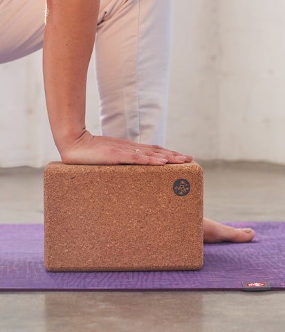 Manduka Cork Block being used for support and balance in an asana - Manduka | Eco Yoga Store