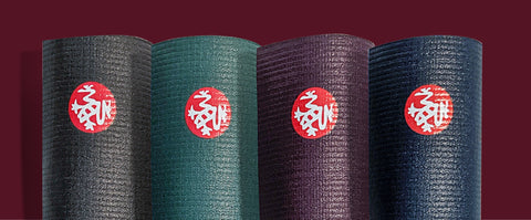 Four PRO yoga mats (Thunder, Lotus, Indulge & Midnight colours) standing vertically side by side - MANDUKA | Eco Yoga Store