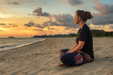 Yogi meditation at the beach | Eco Yoga Store