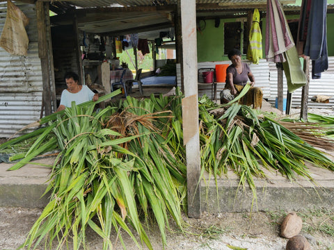 Fijian weavers preparing the freshly cut pandanus leaves - Tali Tali | Eco Yoga Store