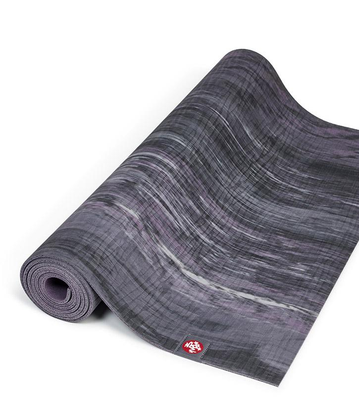 Manduka eKOLite 4mm Yoga Mat - Black Amethyst Marbled - part rolled | Eco Yoga Store