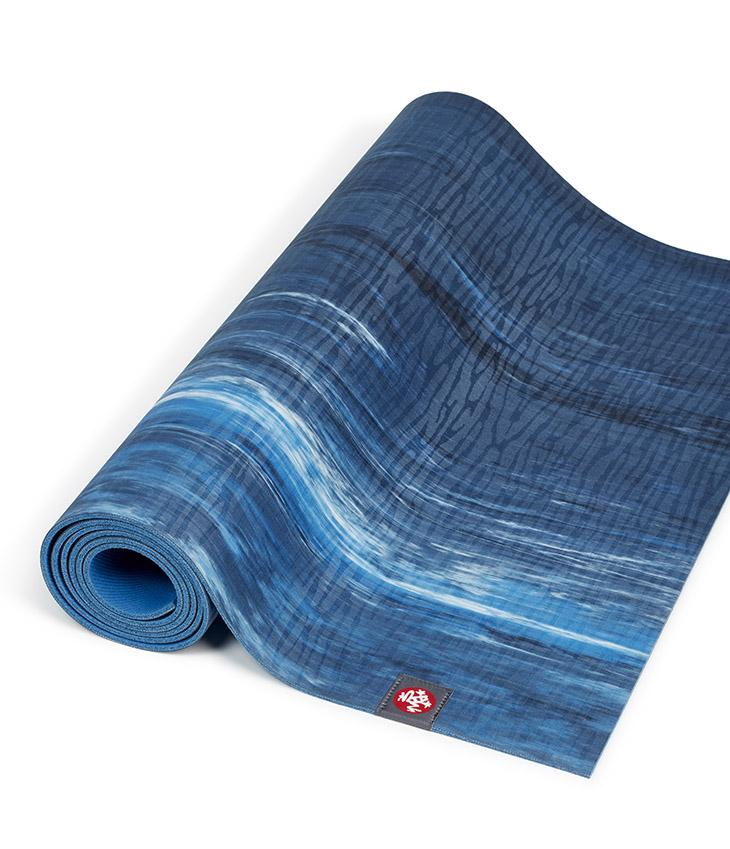 Manduka eKOLite 4mm Yoga Mat - Dark Sapphire Marbled - part rolled | Eco Yoga Store