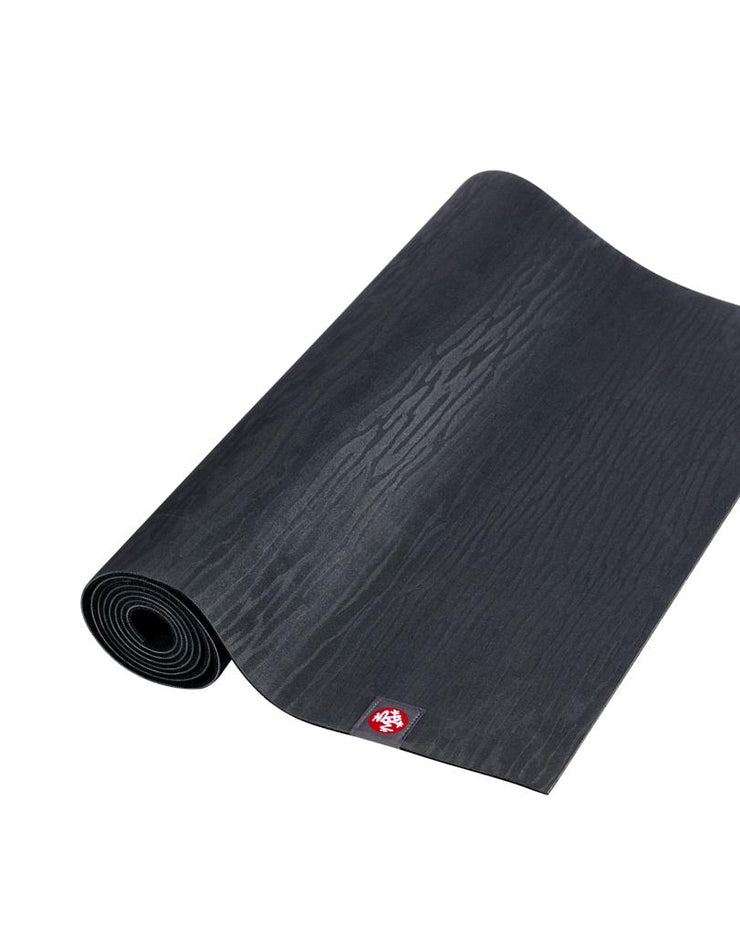 Manduka eKOLite 4mm Yoga Mat - Charcoal - part rolled | Eco Yoga Store