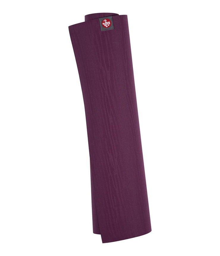Manduka eKOLite 4mm Yoga Mat - Acai Midnight - rolled vertical | Eco Yoga Store