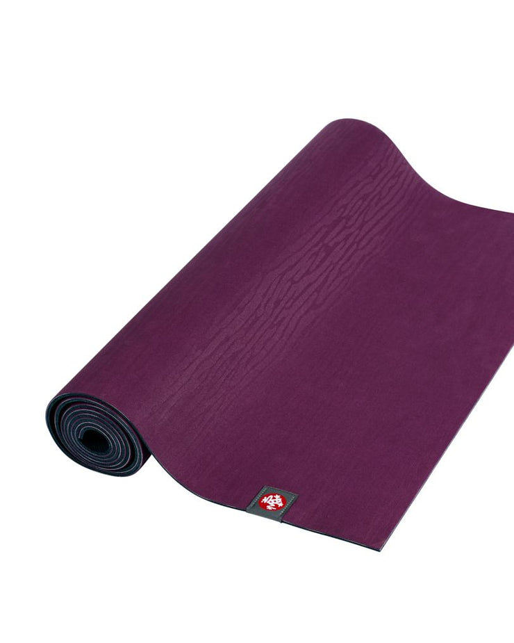 Manduka eKOLite 4mm Yoga Mat - Acai Midnight - part rolled | Eco Yoga Store