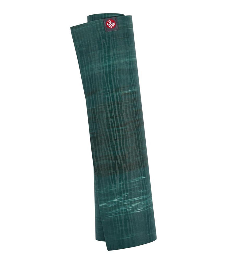 Manduka eKOLite 4mm Yoga Mat - Deep Forest Marbled - rolled vertical | Eco Yoga Store