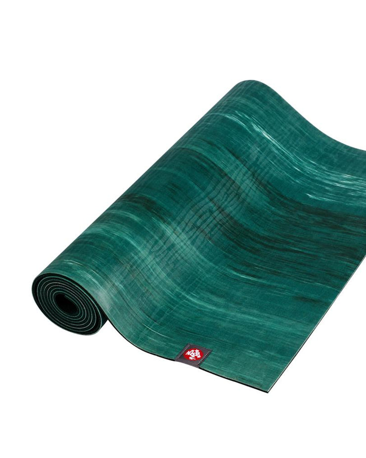 Manduka eKOLite 4mm Yoga Mat - Deep Forest Marbled - part rolled | Eco Yoga Store