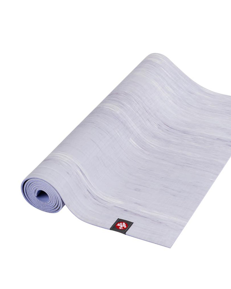 Manduka eKOLite 4mm Yoga Mat - Cosmic Sky Marbled - part rolled | Eco Yoga Store