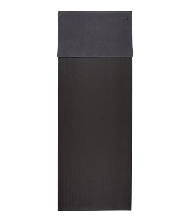 Manduka eQua Hand Towel - Thunder - placed on a yoga mat | Eco Yoga Store
