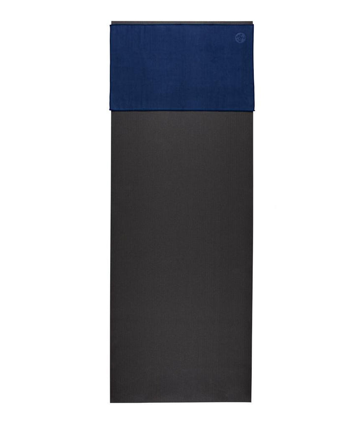 Manduka eQua Hand Towel - Midnight - placed on a yoga mat | Eco Yoga Store