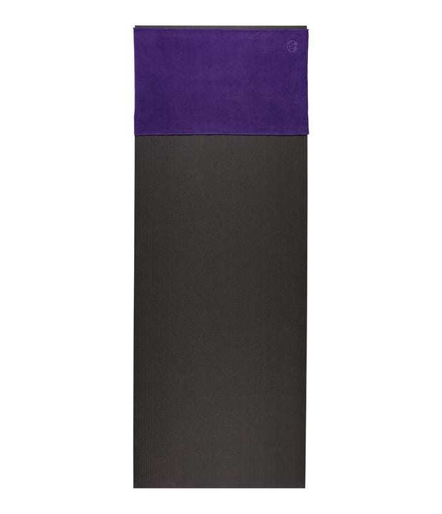 Manduka eQua Hand Towel - Magic - placed on a yoga mat | Eco Yoga Store