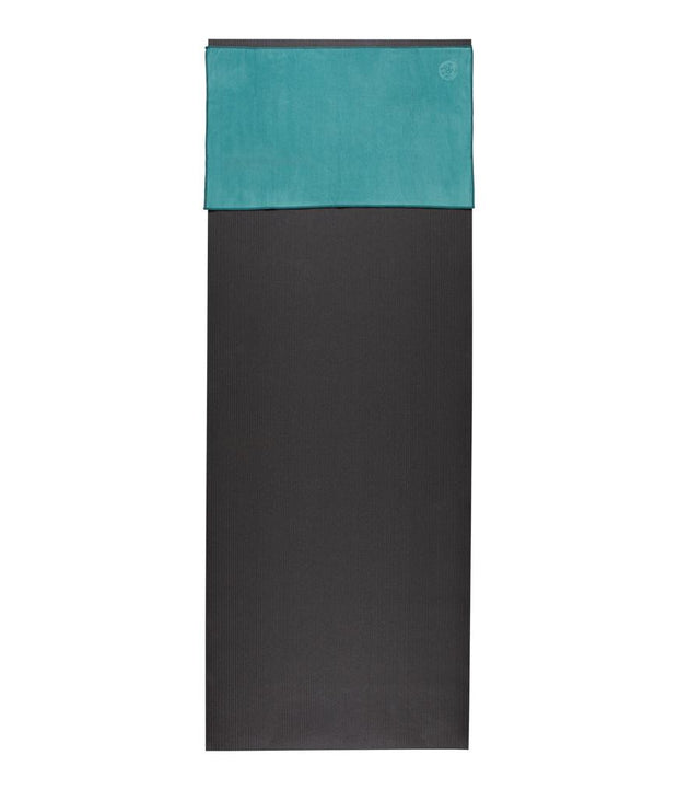 Manduka eQua Hand Towel - Tropical Surf - placed on a yoga mat | Eco Yoga Store