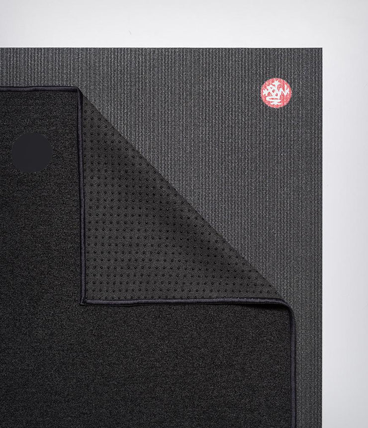 Manduka Yogitoes Mat Towel - Onyx - lying flat, corner folded over | Eco Yoga Store