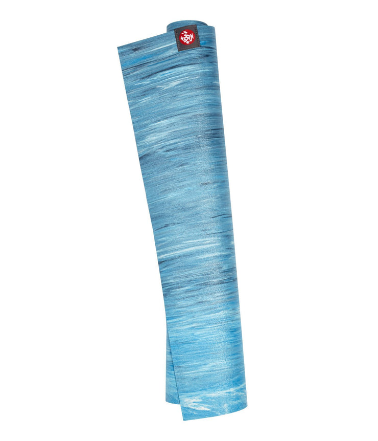 Manduka eKO Superlite 1.5mm Yoga Mat - Dresden Blue Marbled - rolled vertical | Eco Yoga Store