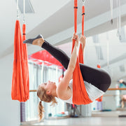 TRIBE Aerial Yoga Swing - suspended in-use - off ground pose | Eco Yoga Store