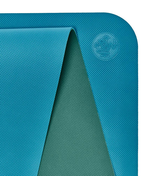 Manduka Begin Mat 5mm Yoga Mat - Bondi Blue - top corner loosely rolled showing both sides | Eco Yoga Store