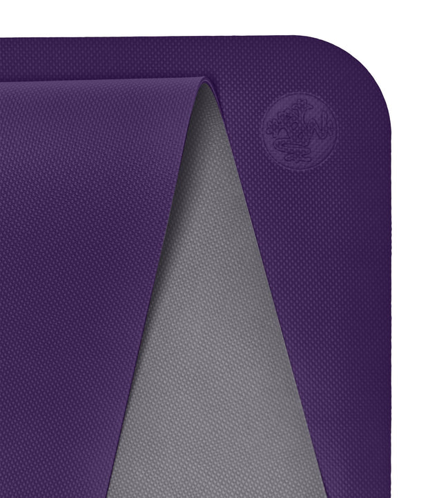 Manduka Begin Mat 5mm Yoga Mat - Magic - top corner loosely rolled showing both sides | Eco Yoga Store