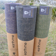 Tribe Earth.Me 4mm Yoga Mats, Amethyst, Cosmos, & Olive Colours, rolled, standing vertically side by side